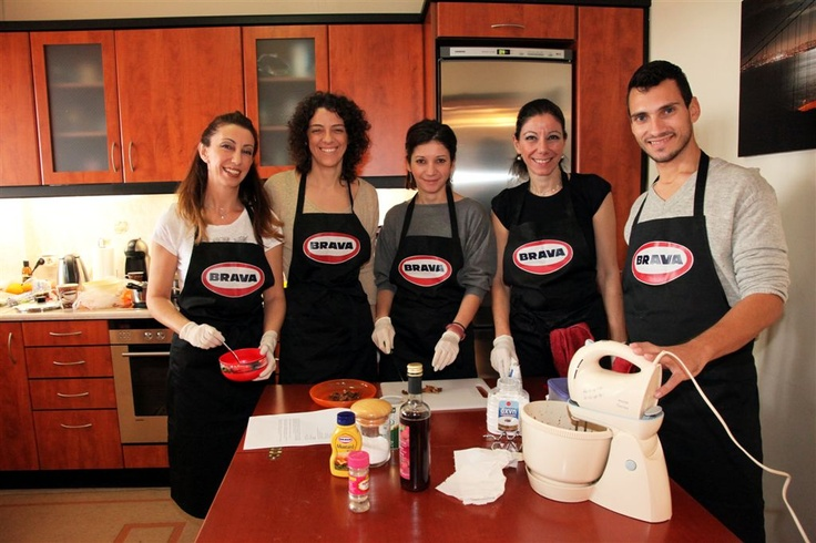Anna and her friends cooking during a HOME COOKING workshop delivered by Foteini Palieraki
