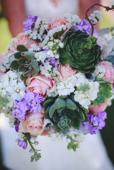 Bouquet with colorful flowers and succulents