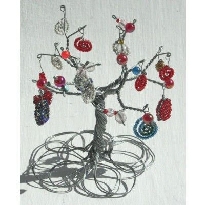 Wire tree of hope crafted from wire with wire beaded ornaments on the tree stems.