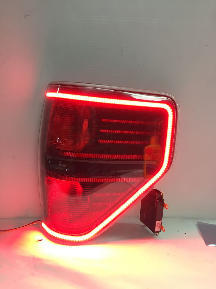 Our custom OEM Ford F150 and Raptor Tail Lights are here! These modified OEM tail lights feature the 2015 style wrap around LED running light that functions as a turn signal too! These tail lights are available in the stock chrome, stock black, murdered out (all black-smoked red lenses) and paint matched bezels! *****PRICED PER …