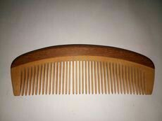 a wooden comb perfect to maintain the beard