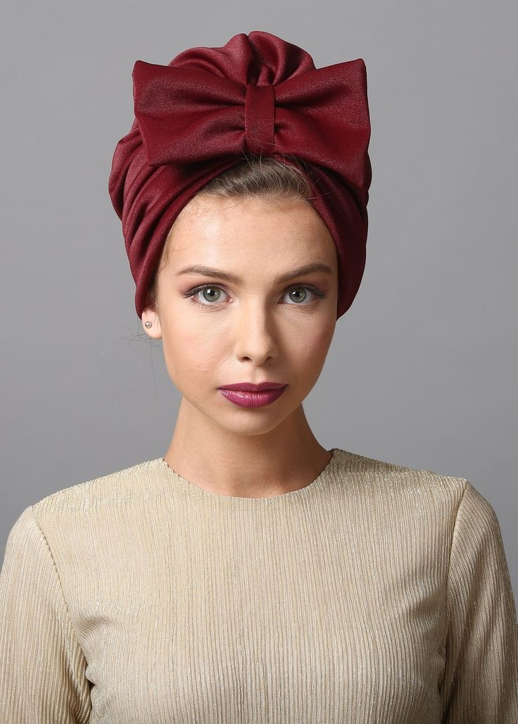 Bow style turban in burgundy. The Turban is stretchy, light, and comfortable. This versatile turban can be worn as a full or partial head covering. Tuck all of your hair in, or wear as a hat, with hair loose.
