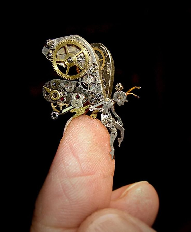 Isn't this sculpture amazing?  This Steampunk Fairy is made of watch parts by All Natural Arts.  So delicate yet and fascinating.