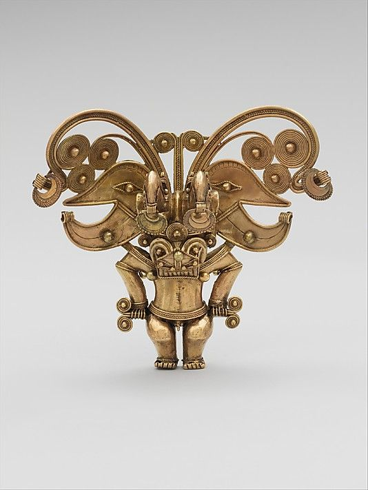Masked Figure Pendant Date: 10th–16th century Geography: Colombia Culture: Tairona Medium: Gold Dimensions: H. 5 1/4 x W. 5 3/4 in. (13.3 x 16.6 cm) Classification: Metal-Ornaments