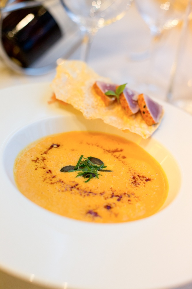 pumpkin cream soup with seared tuna ginger and lentil chips