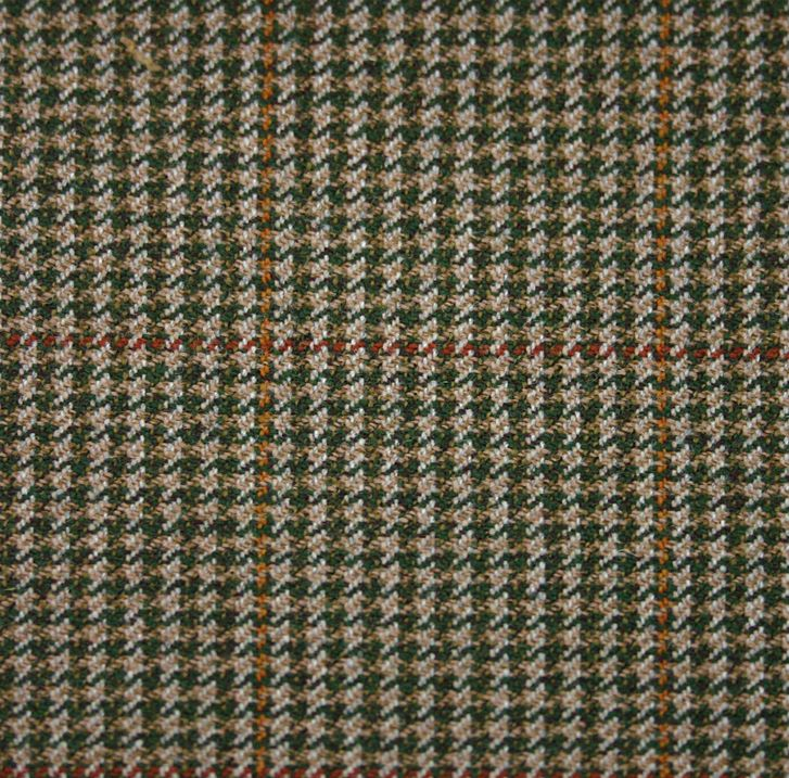 Houndstooth (or Dogtooth) Tweeds -  A type of large broken checked pattern using pointed shapes instead of squares. Said to resemble the jagged back teeth of a dog. 'Houndstooth' describes the pattern in a larger size, 'Dogtooth' when it is smaller. (Hartwist Houndstooth Green 32020 Highland Tweed)