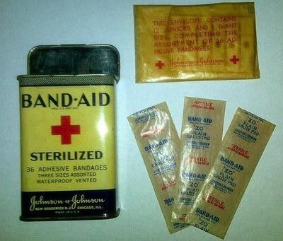 $79 Nice vintage (1940's-50's) Band-Aid tin with some vintage bandages. The tin has some surface wear but no dings nor dents and it snap closes perfectly well. The tin is 3 1/2   high (closed) and 1  wid