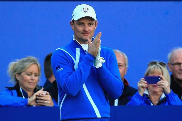Justin Rose of Europe looks on from the 1st tee