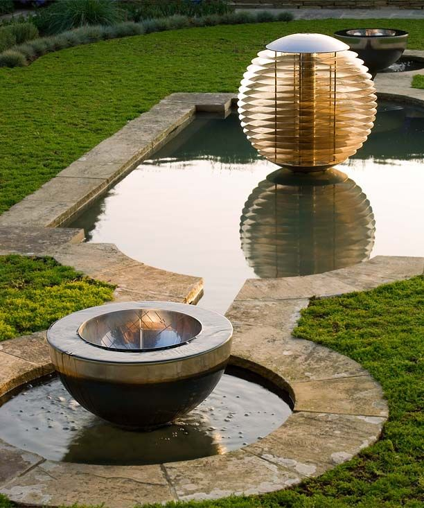 Ether garden globe and Chalice water feature enhancing a pond