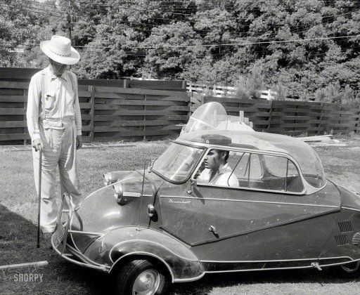 """Elvis Presley in 1956 with his three-wheeled Messerschmitt """"bubble car"""" and Harley-Davidson motorcycle,"""