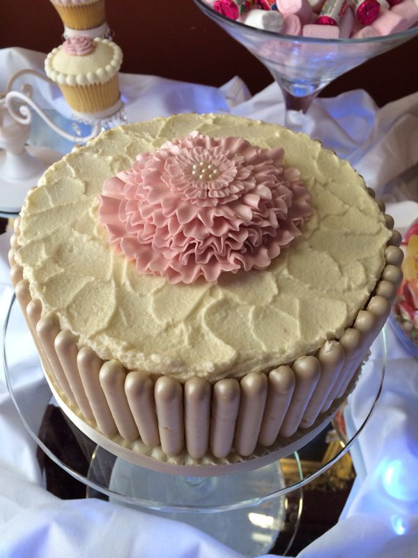 Ruffle flower cake with white chocolate fingers