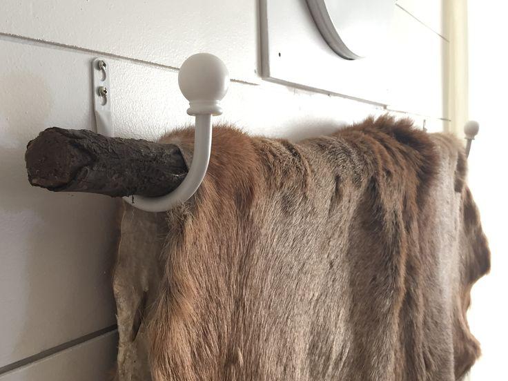 Inexpensive way to hang a deer hide! Get two curtain tie