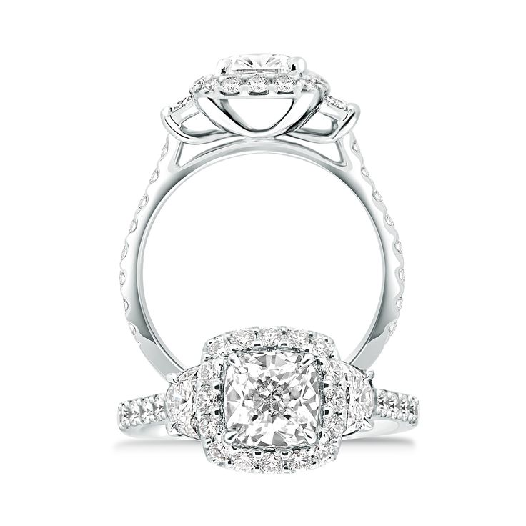 The Nightingale engagement ring  is a heavenly design featuring a cushion shape diamond with half moon accent diamonds surrounded by small brilliant. Handcrafted in 18ct gold or platinum.   #paulbram #diamonds