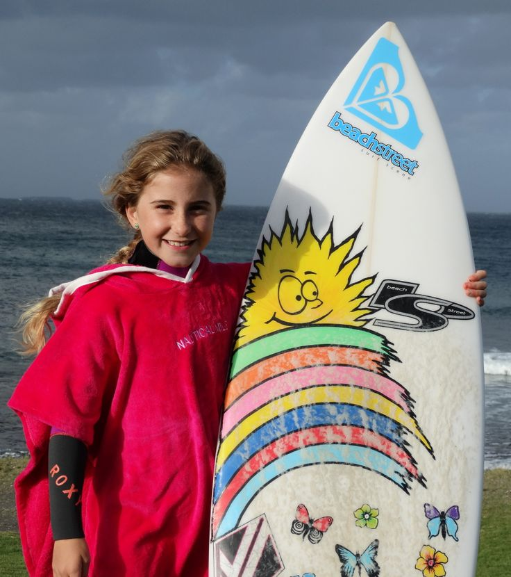 Deep Pink Hoodie Towel by Nautical Mile being worn by junior surf champ Jada Thomas.  www.nauticalmile.com.au