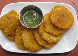 Tostones and ajo sauce(garlic sauce) ~ Caribbean The dish is made from sliced green (unripe) plantainscut either length-wise or width-wise and are twice fried.