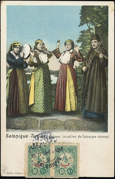 An early 20th century postcard showing Sephardic Jewish ladies of Thessaloniki performing a traditional dance.