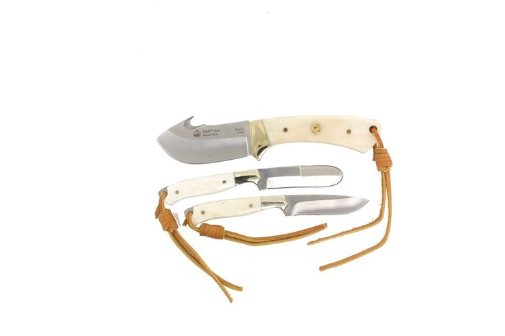Puma Trophy Care Bone Handle Knife Set. Includes 7 inch gut hook, 2.5 inch caping knife, and 2.5 inch fleshing knife. 55-57 Rockwell Hardness. White bone scales. Handmade by skilled craftsman. Lanyard hole.