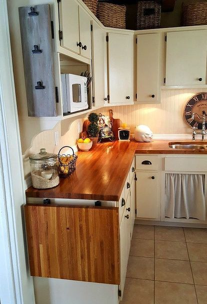 Like the idea of using a shelf for microwave - like shelf over sink as an example. Replace above stove microwave(?microhood correct name?) with hood. Or even use a shelf for toaster over and keep microwave(/microhood?)above stove