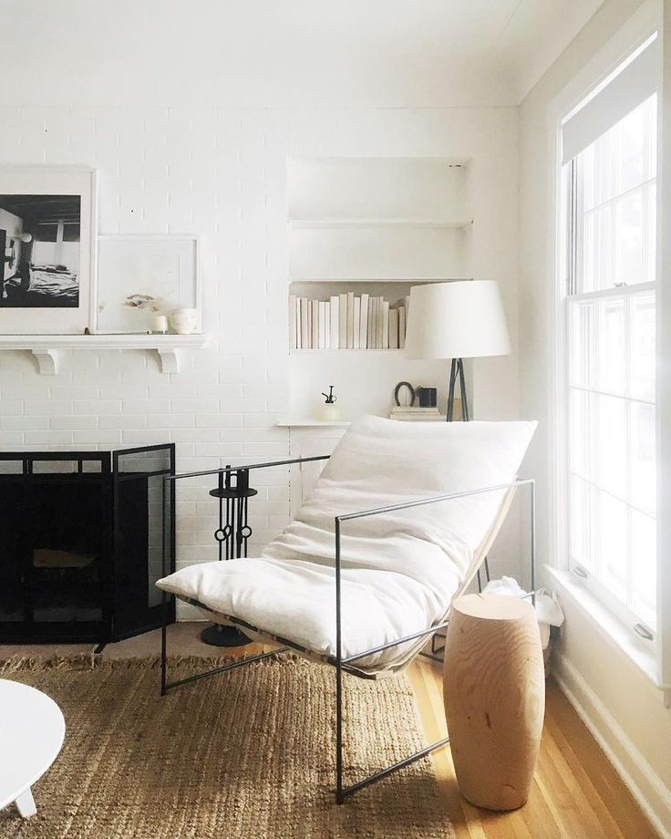 Cozy corner goals with white walls, a modern metal-frame chair, jute rug and more.