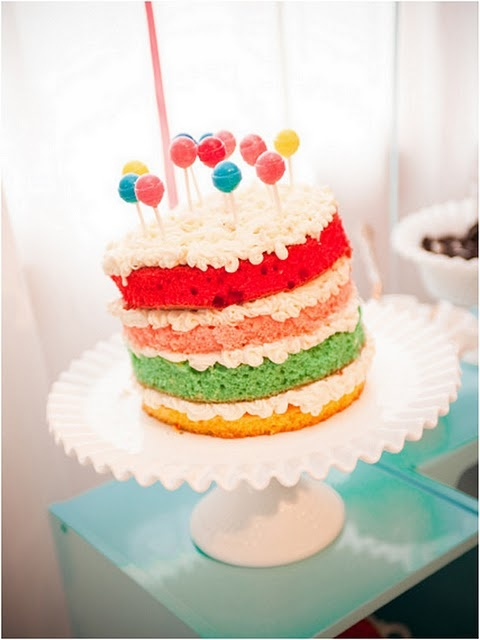 For the love of rainbows, bright colors, and lollipops. simple, beautiful cake.