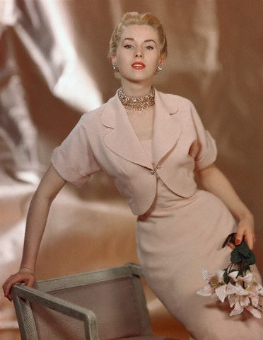 1949 Model is wearing a pink town suit of spun rayon by Joyce Hubrite.