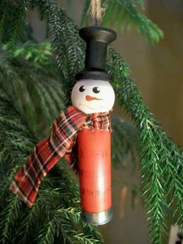"Shotgun Shell Snowman Ornament - added 3 black rhinestones for buttons and used a washer and 3/4"" piece of wooden dowel  and spray painted them black to make the top hat since none of the craft stores had 1"" plastic top hats in stock and there was no time left to order them online. Planning ahead, what a novel idea."