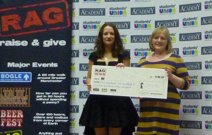 """University of Manchester student Jenny North (left) presents MAG's Lousie Wells with a cheque showing the money raised by Manchester RAG's """"Lost 2014"""" fundraising event. Thanks to everyone who got Lost for MAG! http://www.manchesterrag.com/domestic-challenges-events/lost-2014"""