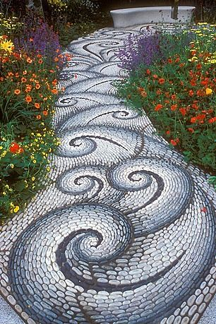 Twists and twirls in this mosaic garden pathway creates a feeling of movement and energy.