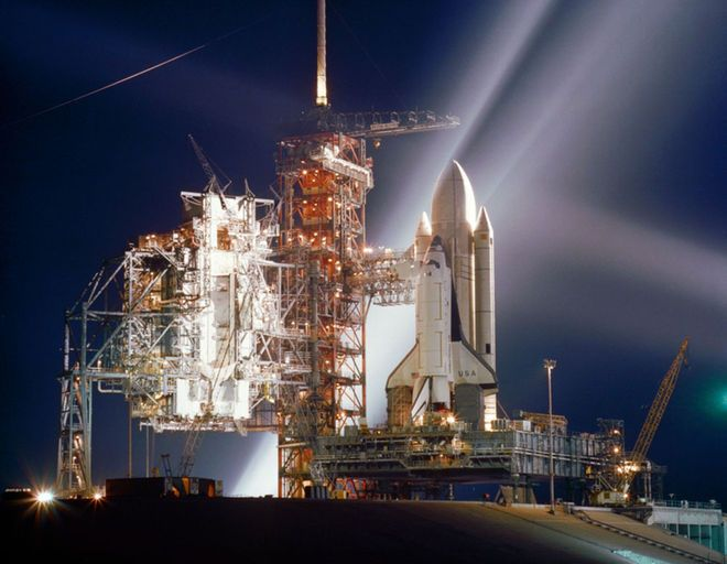 The space shuttle Columbia, NASA's first orbiter, is showered with lights in this nocturnal scene at Launch Pad 39A at the Kennedy Space Center in Cape Canaveral, Fla., during preparations for the first flight (STS-1) of NASA's new reusable spacecraft system. This photo was taken in March 1981 ahead of Columbia's April 12, 1981 launch.