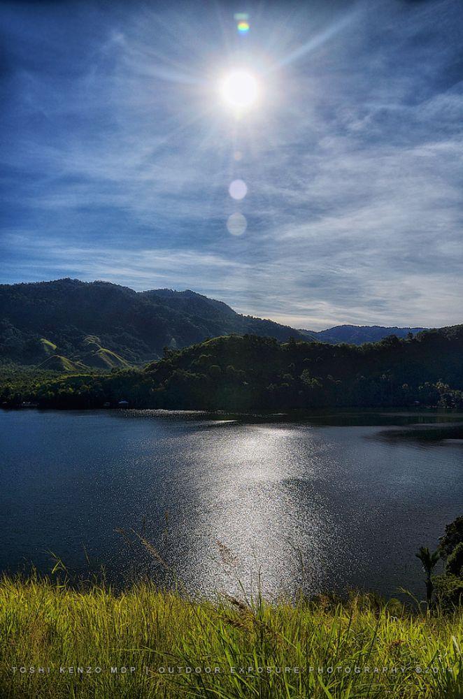 Sun and Its Reflection on Lake Sentani by TOSHI KENZO MDP™