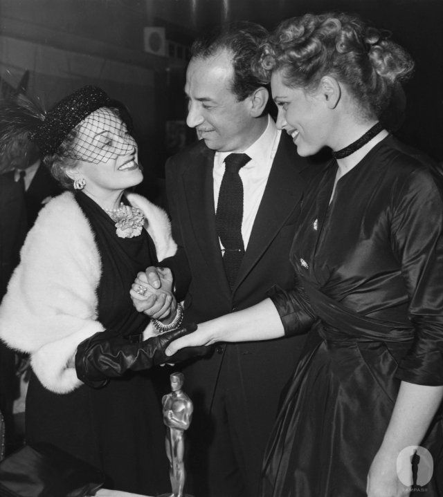 """Presenter Gloria Swanson with Best Actor Jose Ferrer (""""Cyrano de Bergerac"""") and Best Actress Judy Holliday (""""Born Yesterday"""") at the 23rd Academy Awards."""