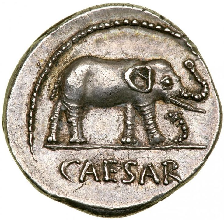 Julius Caesar. Silver Denarius (3.98 g), 49-48 BC.. EF Military mint traveling with Caesar. CAESAR in exergue, elephant advancing right, trampling horned serpent. Pontifical implements: simpulum, sprinkler, axe and priest's hat. Crawford 443/1; HCRI 9; Sydenham 1006; RSC 49. Well struck in high relief with pleasing old cabinet toning. Perhaps the most ubiquitous of Caesar's denarii, this famous issue was struck at the time of his crossing of the Rubicon and the beginning of the long period…