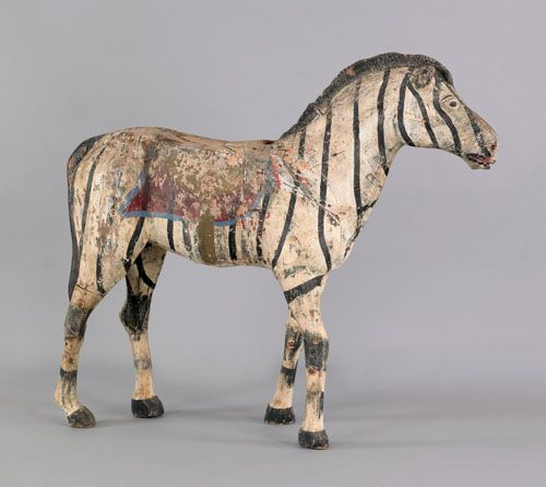 "Carved and painted zebra carousel figure, ca. 1900, retaining an old surface, 43"" h."