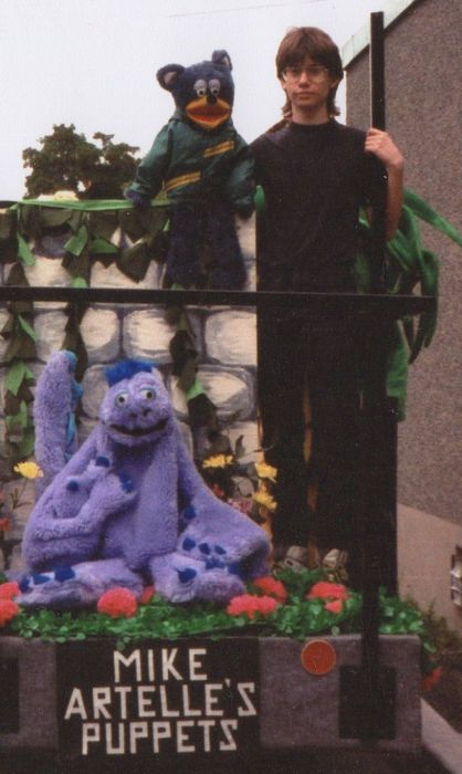 In my mid teens on a Westboro Village parade float with my puppets Tyler the Bear and Gordon the Sea Monster, late 1980's.