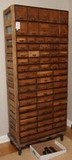 Multi-drawer Storage Unit -  On rubber caster wheels. Misc sizes of drawers, 67 drawers in total. Includes tray with vintage printing press letters. 32x15x68. Sold for $930