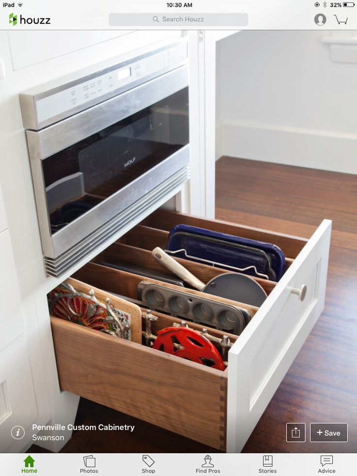 Like this pan storage, easy to pull out of drawer instead of fighting with the pans in a cabinet!