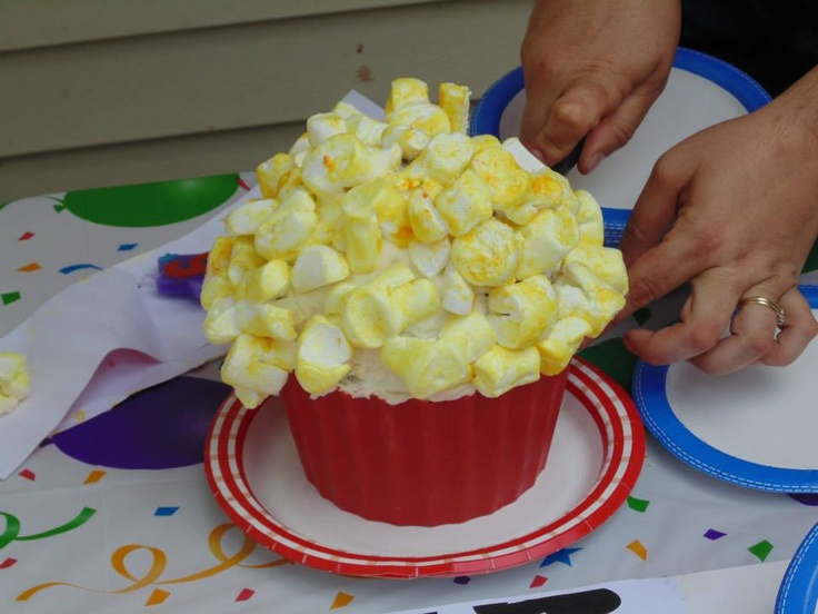 Popcorn bucket cake - made with big top cupcake - popcorn = marshmallows cut and yellow food coloring added