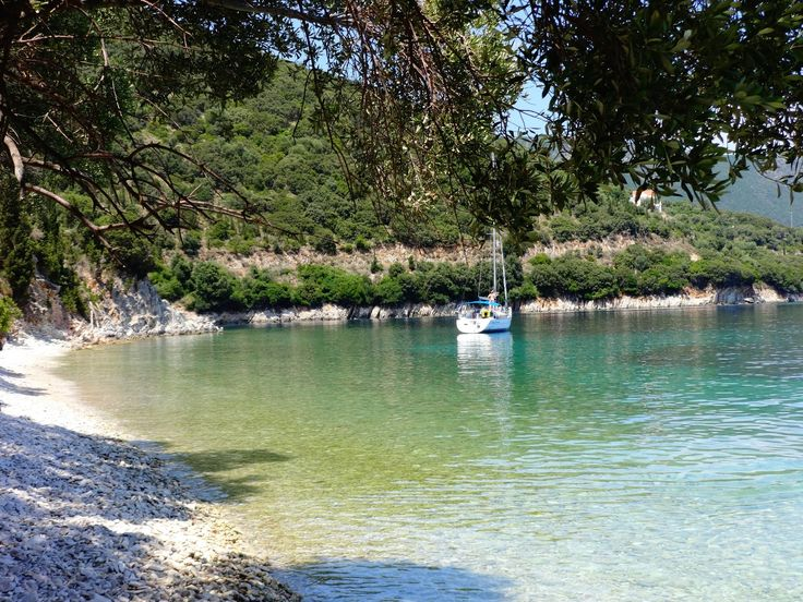 Plakoutses is a quiet and isolated beach in Kioni, Ithaca, with blue waters and olive trees that reach the sea. #Greece #Ithaca #Terrabook #GreekIslands #Travel #GreeceTravel #GreecePhotografy #GreekPhotos #Traveling #Travelling #Holiday #Summer