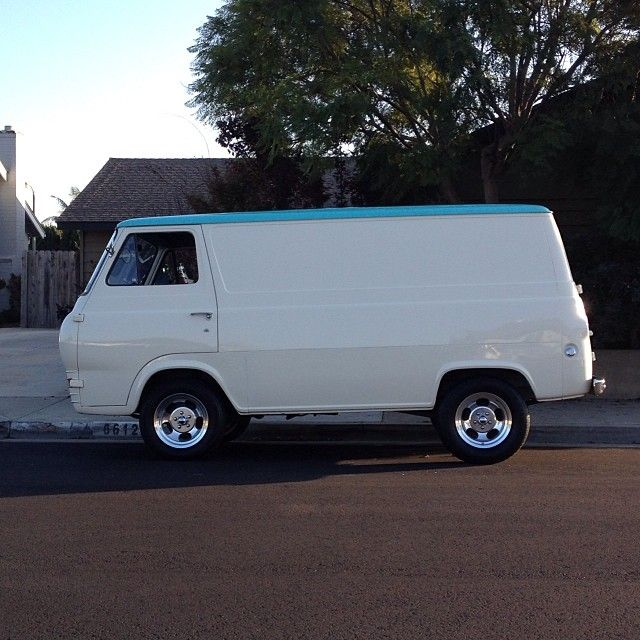 White 1960s Ford Econoline delivery van with light blue roof