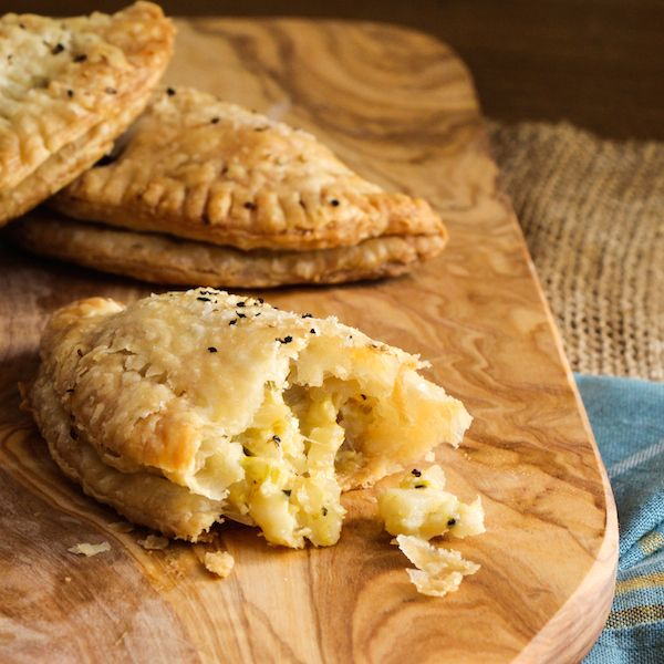 Flakey Cornish Pasties filled with creamy celery root, potatoes, leeks and pickled apples just in time for St. Patrick's Day!
