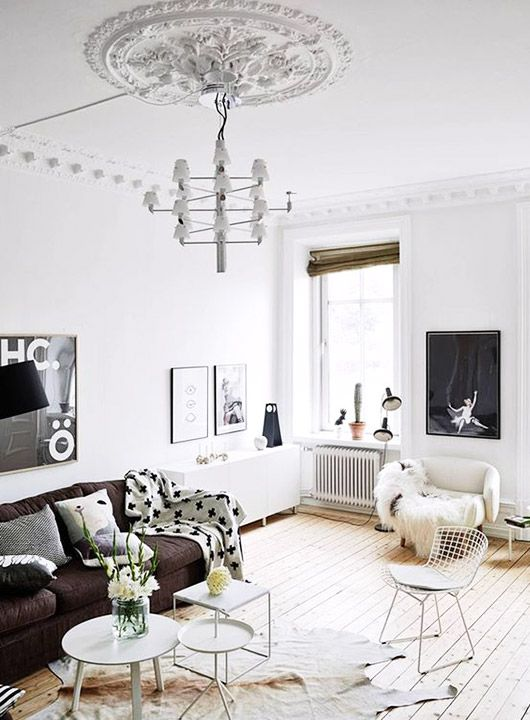 modern living room with large ornate ceiling medallion and tiered pendant light fixture / sfgirlbybay