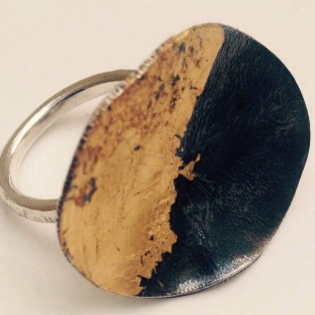 Oxidized cup ring with gold leaf finish