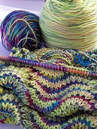 """From """"the good stitch"""" » Fricknits' scarf - a happy use of a very simple repeat pattern and an inspired choice of a """"pretty color"""" with """"an ugly color"""":"""