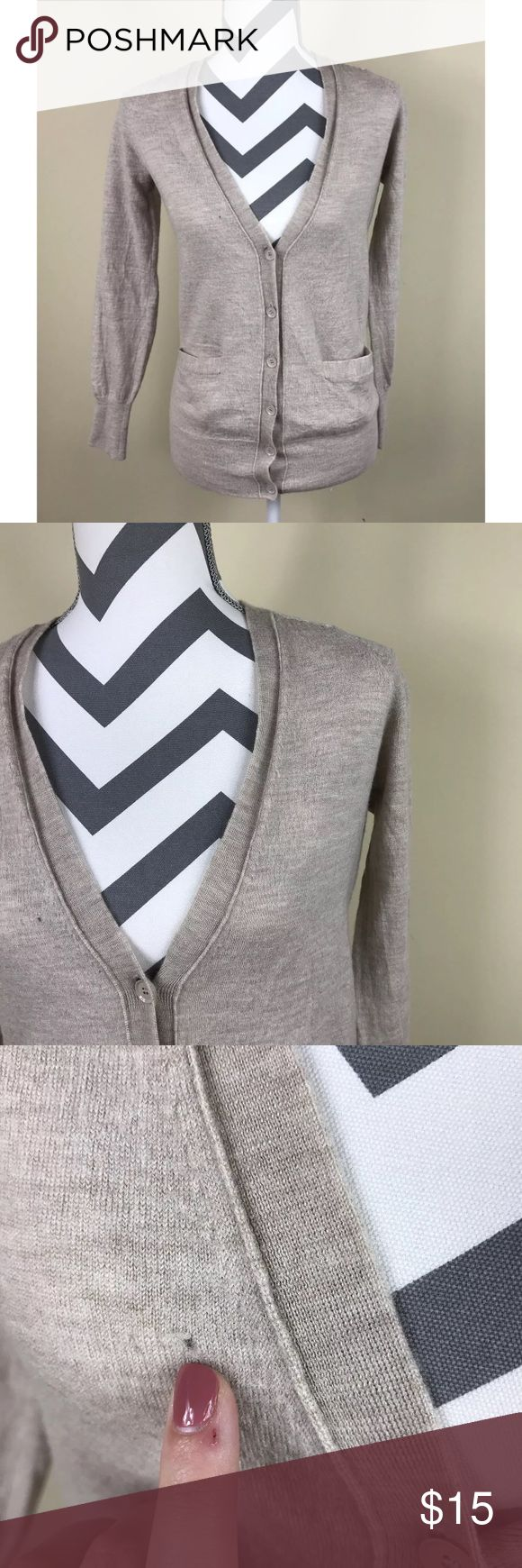 """{J Crew}Tan Wool Long Sleeve Button Down Cardigan Very Good Pre-loved Condition -- there is a moth hole on the front as noted in the picture  Size: Women's Medium Measured laying down flat: 25.5"""" long, 16.5"""" long sleeves, 23.5"""" long sleeves Material: 100% Merino Wool Description: Button Down front, Y-neckline, long sleeves, front pocket, stretchy, thicker material, classic solid color, the cardigan is kind of shaggy but that's due to being wool material  Comes from a Smoke Free Home   ID…"""
