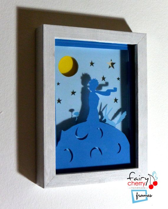 This is a framed hand cut picture featuring the Little Prince. From the famous book of Antoine de Saint-Exupéry, the Little Prince, with his friends the fox and the rose on his famous asteroid watching the moon and the stars! Five colored papers, hand cut and layered to provide a 3D scene. Placed in a wooden frame protected with glass. It can be easily hanged cause it has enough space behind for the nails to fit (nails included)! In that way nails will also stay hidden! Available in two…