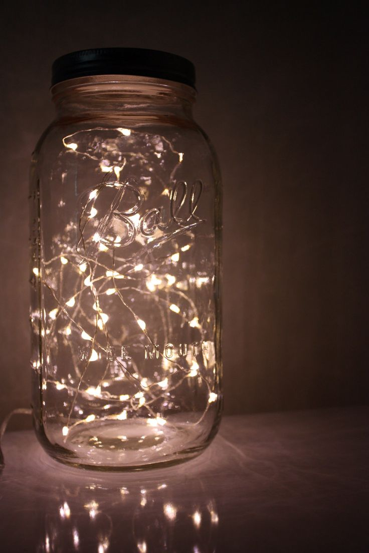 LOVE this.  I really want to find these tiny lights for projects!  Battery powered would be cool too.  Nostalgic Lightening Bug Mason Jar by ShelbyLea - Half Gallon Battery Operated