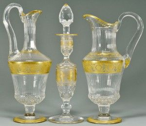 "St. Louis Cut Crystal Candlestick, Cut Crystal Pitcher And Cut Crystal Decanter, All with Classical Gilt Foliate Decoration And Acid Etched ""Cristal St. Louis France"" Stamp To Base    c. 20th Century"