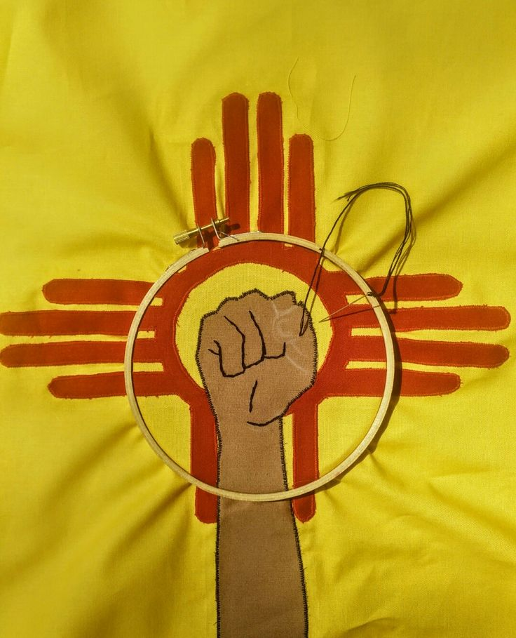 Work in progress of the embroidery on the custom piece I made for my friend's bookstore launch. She's from New Mexico so I combined the fist, which is in her logo, with the Zia from the NM flag. #newmexico #zia #flag #sewing #embroidery #wip #workinprogress #art #fabric #handmade #friend #gift #custom #needle #thread #hangthebastards
