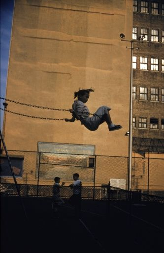 1956: A girl enjoys a swing in a city playground, New York. (Photo by Ernst Haas/Ernst Haas/Getty Images)