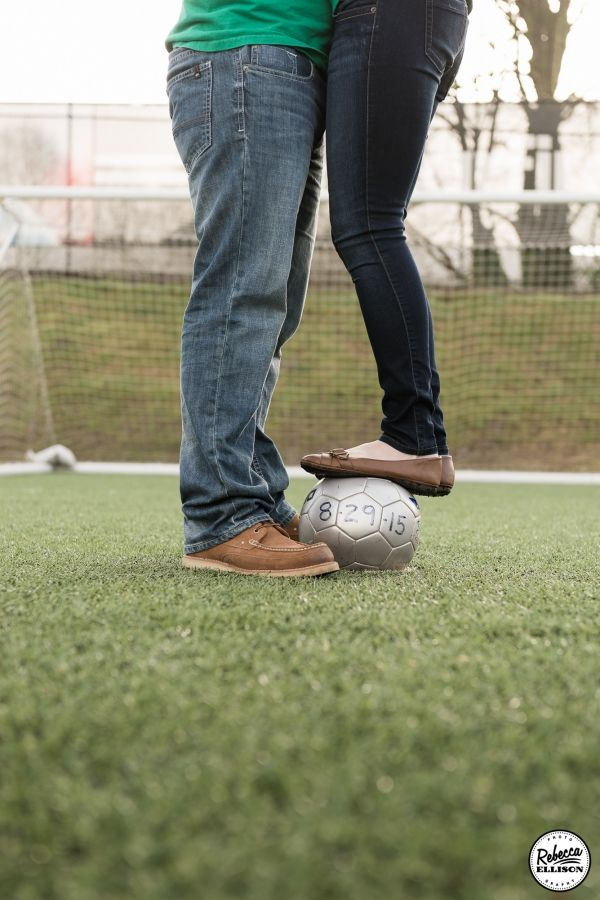 spitfire soccer engagement photo with a soccer ball showing wedding date